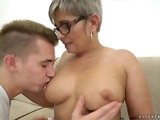 Grandma deepthroats a young big dick before riding on it